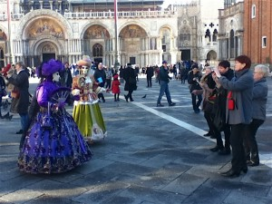 Elaborately costumed characters march around in pairs all over Venice, not just in Piazza San Marco.